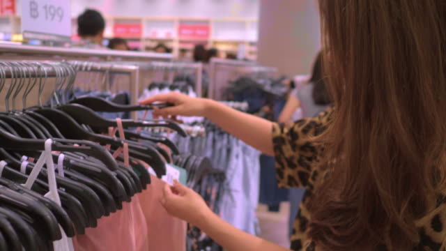 Hands Picking out clothes from a rack