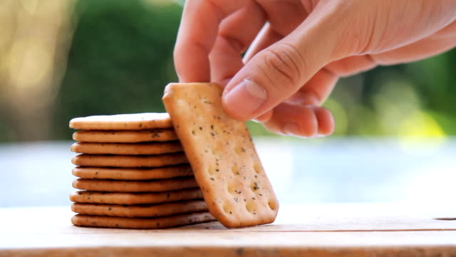 hands picking up a stack of cracker video