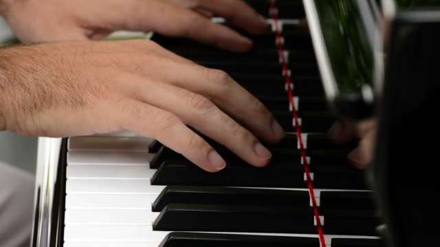 Hands playing piano close up