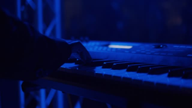Hands Playing The White Piano