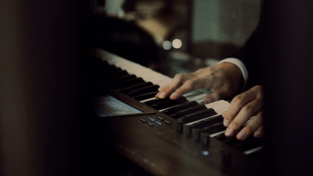 Hands Playing The White Piano video