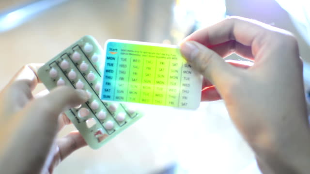 Hands Pressing Pill out of  Contraceptive video