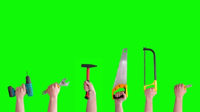 Hands raise different instruments, tools isolated on green screen. Mechanic tools concept