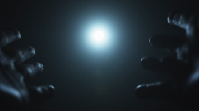 hands reaching for the light, sun or moon. worship, ritual and hope concepts. - avvicinarsi video stock e b–roll