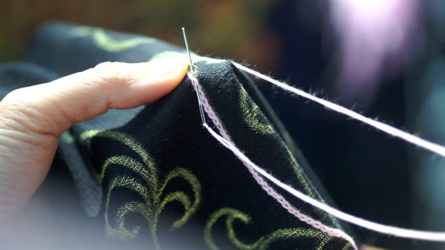 Hands sewing fabric with needle. Hands sewing fabric with needle. arthropod stock videos & royalty-free footage