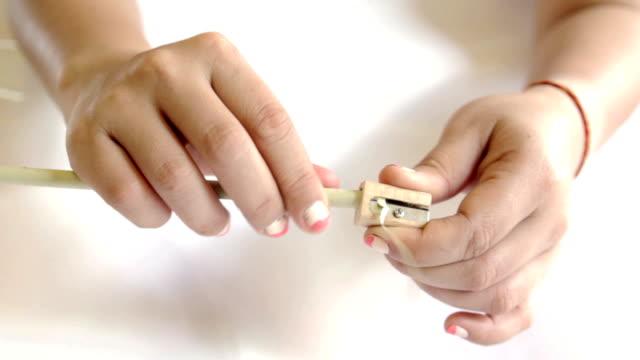 Hands Sharpening a Pencil video