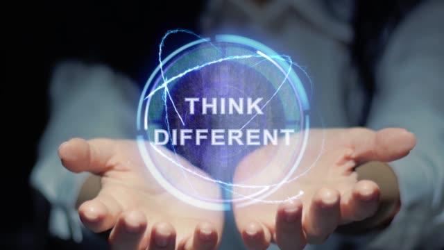 Hands show round hologram Think different