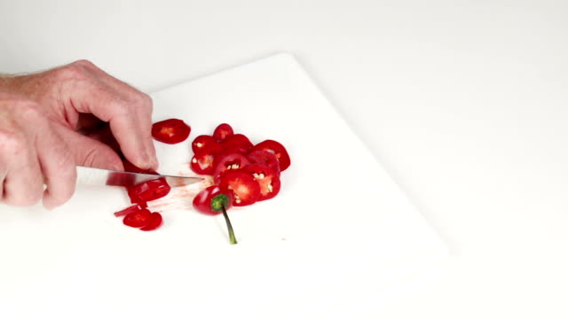 Hands Slicing Red Jalapeno with a Knife video