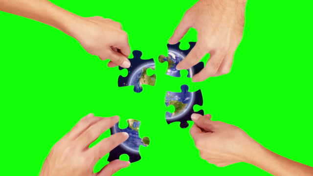 Hands solving a puzzle. Green Screen and Wood. Earth. video