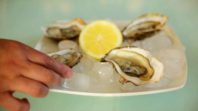 Hands take a plate oyster video
