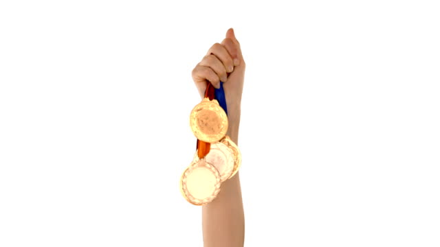 Hands throwing some medals video