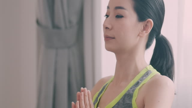 Hands together and breath. Single woman, Non-Caucasian only, Thailand, Yoga,one mid adult woman only, anticipation stock videos & royalty-free footage