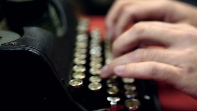 Hands typing on antique typewriter, closeup, vintage typescript collection video