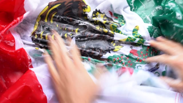 Hands Washing Mexican Flag - Change Mexico/Corruption Concept video