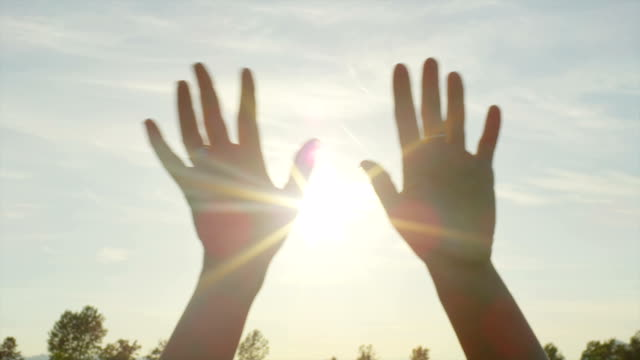 SLOW MOTION CLOSE UP: Hands waving over the sunny sky SLOW MOTION CLOSE UP: Hands waving over the sunny sky goodbye single word stock videos & royalty-free footage