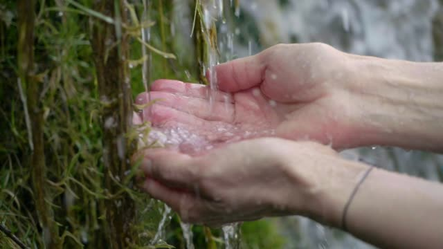 Hands With Pure Spring Water. Crystal Clear Mountain Water video