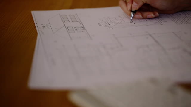 Hands Young female architect working on blueprint video