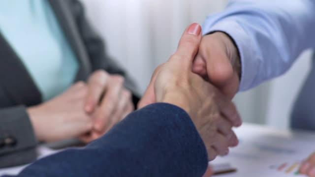 Handshake after negotiations, positive lending decision, property investor video
