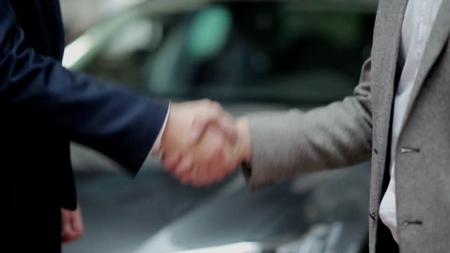 Handshake and handing over the keys video