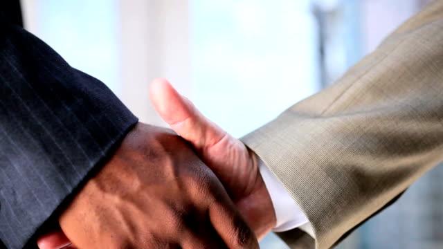 Handshake Between City Businessmen video