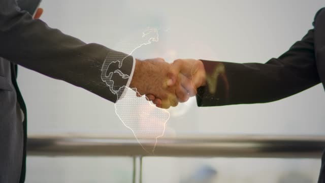 handshake concept, handshake of two businessmen on the background of the planet earth, background with digital map, world business shake hand with world maps rendered with computer graphic. - fiducia video stock e b–roll
