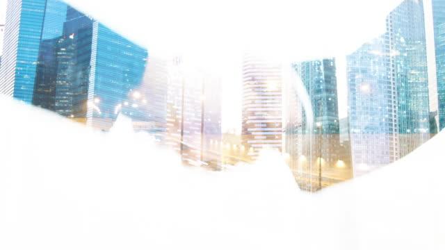 handshake on city background. - fiducia video stock e b–roll