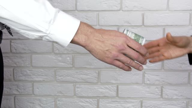 handslag. - dirty money bildbanksvideor och videomaterial från bakom kulisserna