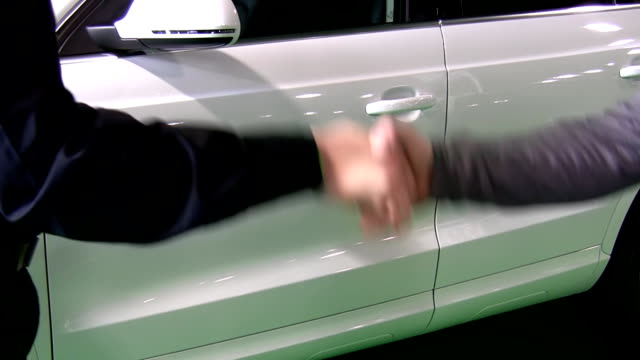 Handshake. White car sale contract between customer and dealer video