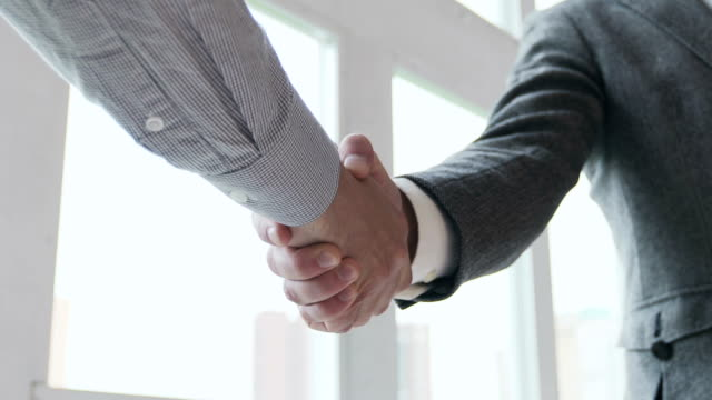 Handshaking in a office. Slow motion video
