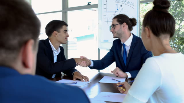 Handshaking of two businessmen during a successful deal video