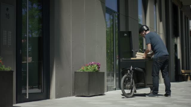 Handsome bike courier unloads his cargo bike video