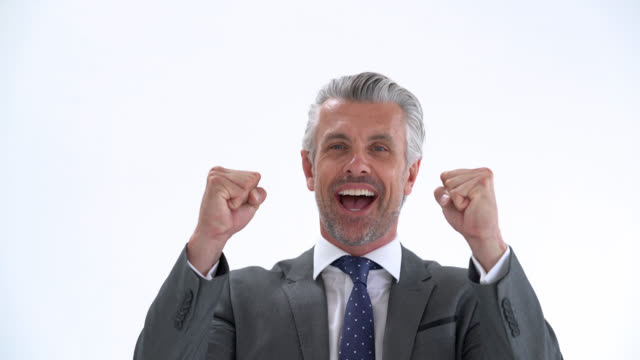 Handsome business man celebrating with arms raised and excited video