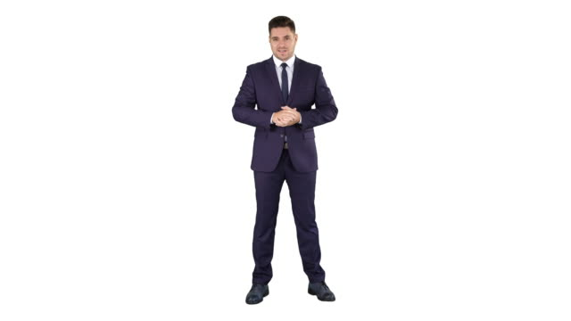 handsome businessman looking in camera and talking on white background - stare in piedi video stock e b–roll