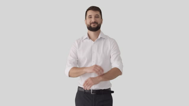 Handsome businessman smiling Portrait of confident businessman smiling over white background arms akimbo stock videos & royalty-free footage