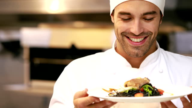 Handsome chef smelling dish and doing ok sign video