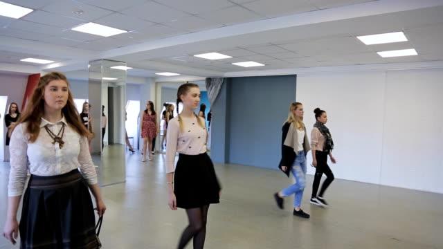 Handsome females train in catwalk in spacious ballroom video