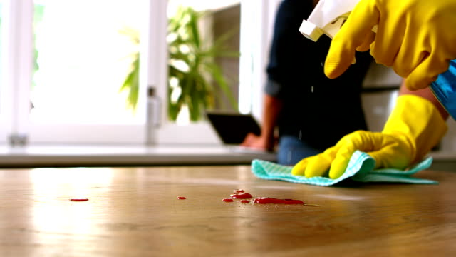 Handsome man cleaning table video