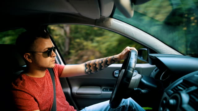 Handsome man driving car Handsome man driving car luxury car stock videos & royalty-free footage