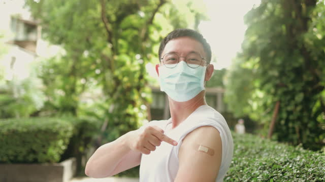 Handsome man feel confident after get vaccine during Covid 19 epidemic - stock video video