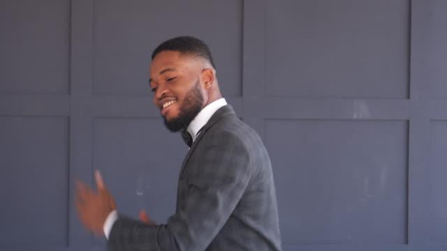 Handsome man in tuxedo dancing outdoors video