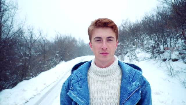 Handsome man in winter walk video