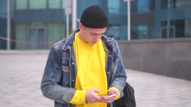 Handsome man text messaging on mobile phone