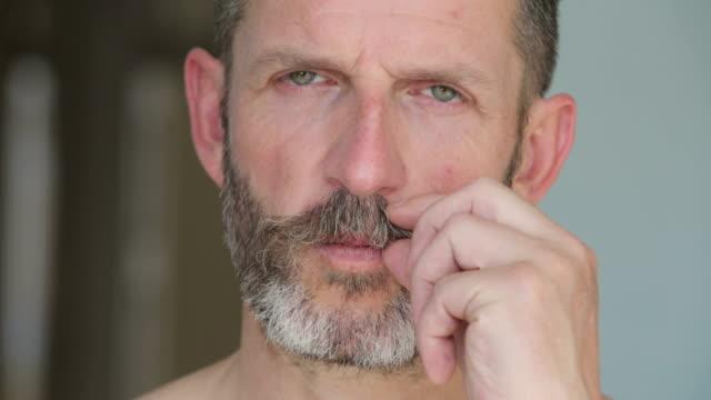 handsome man twirls his mustache video