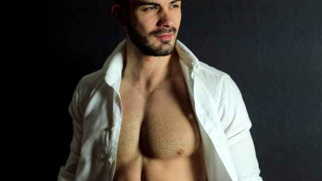 Handsome man Handsome man with unbuttoned shirt sensualitet stock videos & royalty-free footage