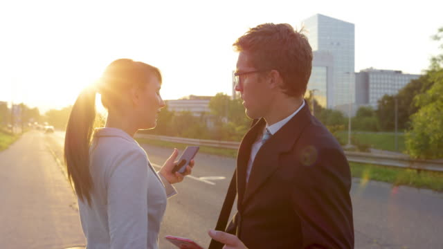 LENS FLARE: Handsome man walking to work and texting crashes into businesswoman.