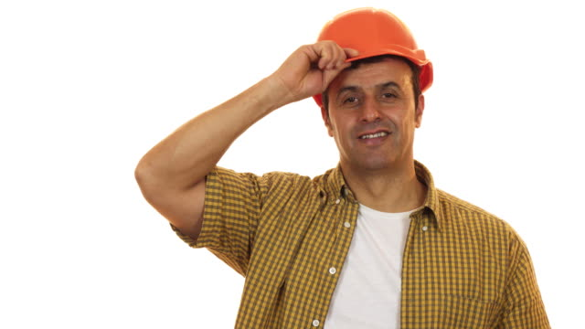 handsome mature engineer wearing hardhat smiling confidently - craftsman architecture stock videos & royalty-free footage