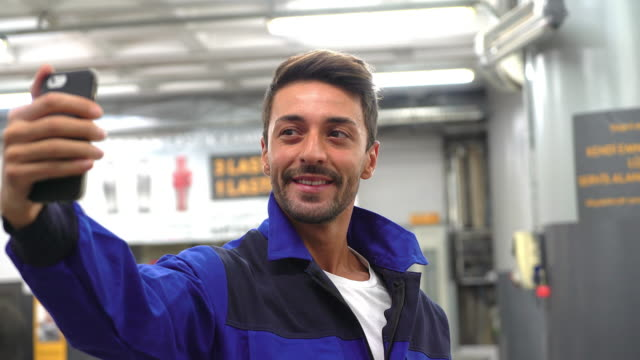 Handsome mechanic taken selfie for social media in car services video