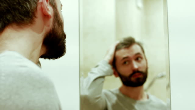 Handsome men with beard behind the mirrow video