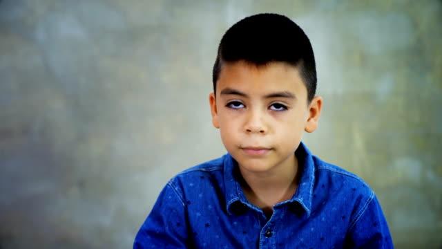 handsome mixed race boy talks to camera - znak ok filmów i materiałów b-roll