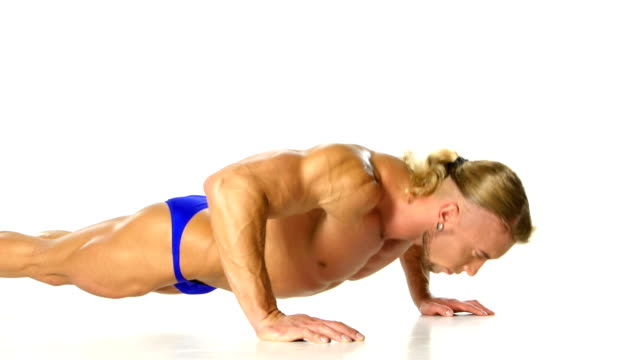 Handsome muscular man doing push-up on white background video
